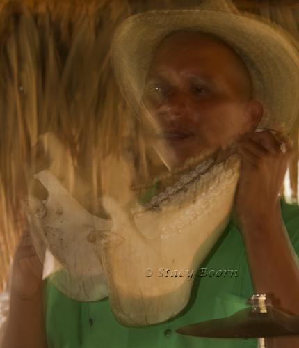 Rhythmically rattling a horse jaw bone – Fiesta Campesina